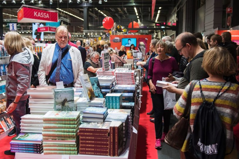 People browsing books at the Gothenburg Book Fair.