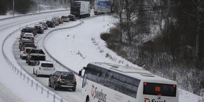 Heavy traffic on a Swedish road covered in snow.
