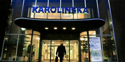 A man walks into the entrance of the Karolinska University Hospital in Stockholm.