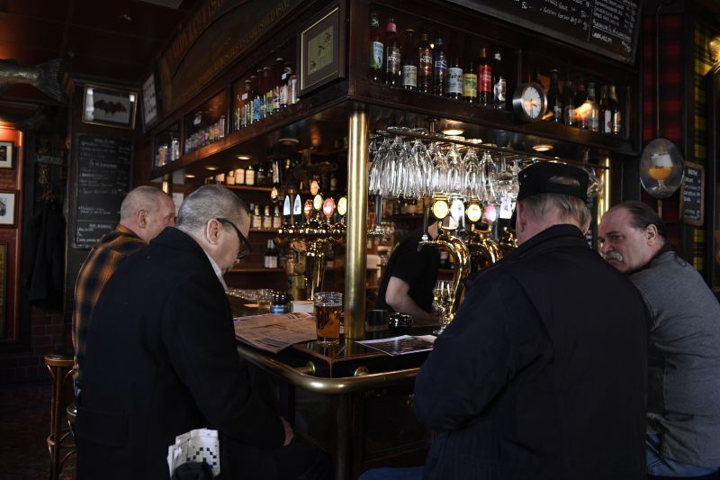 People gather for a drink at a pub in central Stockholm on March 23.